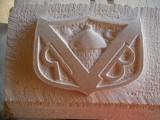 Blason sculpté sur une clef de voute